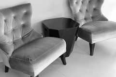 Velvet chair and black sofa table, black and white Stock Photos