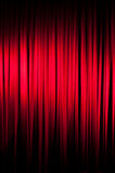 The Velvet Curtain Series. Red velvet stage curtain with a spotlight on it.  Vignetting added for effect Stock Photography