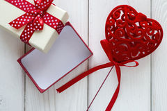 Velvet heart with a bow near the gift box Stock Images