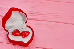 Velvet heart shaped box with earring. Gift box in a shape of heart with two small hearts, copy space. Gift for Valentines Day Stock Image
