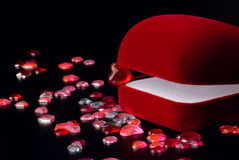 Velvet jewellery box and hearts Stock Images
