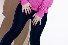 Velvet leggings. Girl wearing velvet leggings and pink shirt, sexy red nails Stock Photos