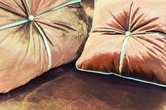Velvet pillows on the brown sofa Royalty Free Stock Images