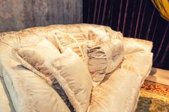 Velvet pillows on the light brown sofa Royalty Free Stock Images