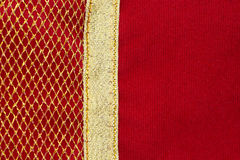 Velvet red with golden net fabric Stock Photography