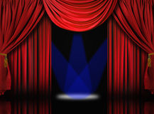 Velvet Theater Stage Drape Curtains With Blue Spot. Beautiful Red Velvet Theater Stage Drape Curtains With Blue Spotlights Royalty Free Stock Photos