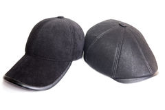 Velveteen sports cap and black leather cap. Black velveteen sports cap and black leather cap on a white background Stock Image