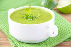 Velvety cream soup from a gentle green peas Royalty Free Stock Images