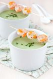Velvety green cream soup of broccoli, peas, spinach, fry shrimp Stock Photography