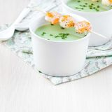 Velvety green cream soup of broccoli, peas, spinach, fry shrimp Stock Photo