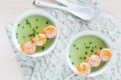 Velvety green cream soup of broccoli, peas, spinach, fry shrimp Royalty Free Stock Photo