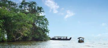 Vembanad lake at Kottayam. Kumarakom, a tiny fishing village on the outskirts of Kottayam Kerala attracts many tourists with the serene beauty of its backwaters Stock Photos