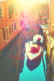 Vemice in the sunshine. Venetian canal with moored boats in the sunshine, Venice Stock Image