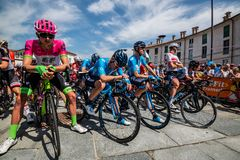 Venaria Reale, Italy May 25, 2018: Professional Cyclists  start the last hard montain stage of the Tour of Italy 2018. From Venaria Reale and arrival uphill in stock photography