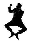 Vencedor do homem da silhueta no salto do telefone Fotografia de Stock