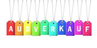 A venda alemão de Ausverkauf da palavra no arco-íris coloriu preços Imagens de Stock Royalty Free