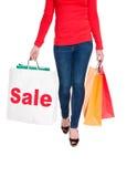 Venda de anúncio carreg do saco de compra da mulher Imagem de Stock Royalty Free