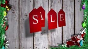 A venda vermelha etiqueta a suspensão contra a madeira com as decorações festivas ilustração stock