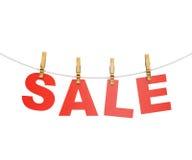 A venda vermelha rotula a suspensão na corda com pregador de roupa Imagem de Stock Royalty Free