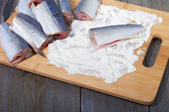 Vendace prepared for frying. Lies on table stock images