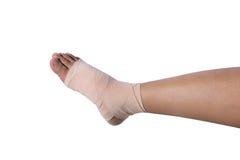 Vendaje de la medicina en el pie humano aislado Foto de archivo