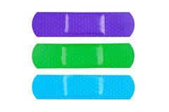 Vendajes adhesivos coloridos Foto de archivo libre de regalías