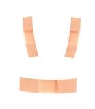 Vendajes sonrientes del pegamento de la cara Imagen de archivo
