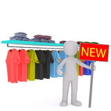 Vendedor Advertising New Stock na loja de roupa Fotos de Stock