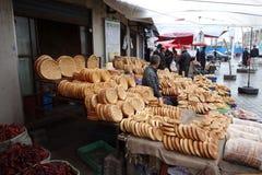 Vendedor ambulante chino del Uighur imagenes de archivo