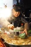 Vendedor ambulante de la noche Imagen de archivo libre de regalías
