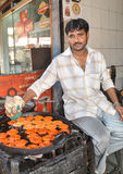 Vendedor ambulante na Índia