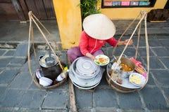 Vendedor ambulante na cidade antiga de Hoian, Vietname Foto de Stock Royalty Free