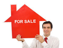 Vendedor con la casa para la muestra de la venta Imagenes de archivo