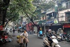 Vendedor de la mujer, Hanoi, Vietnam Imagen de archivo libre de regalías