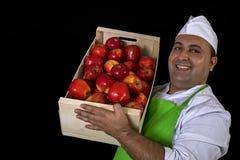 Vendedor do fruto com maçãs Imagem de Stock