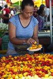 Vendedor em um mercado Fotos de Stock