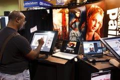 Vendedor en la conferencia y la expo del mundo de Photoshop Fotos de archivo