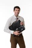 Vendedor sonriente con una cartera Fotos de archivo libres de regalías
