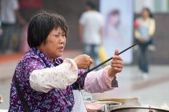 Vendedores en China Imagenes de archivo