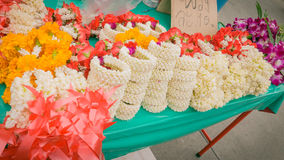 Vender selling flower garland thai style local market. Royalty Free Stock Photos