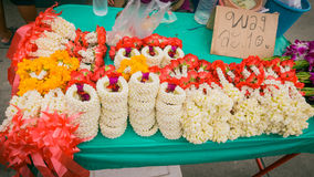 Vender selling flower garland thai style local market. Vender selling flower garland thai style local market at temple in Bangkok , Asia , Thailand Stock Image