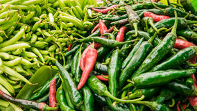 Vender selling variety of  foods and vegetables local market. Stock Photography