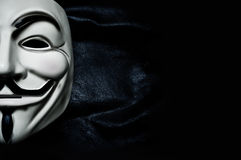 Vendetta mask on black background . This mask is a well-known symbol for the online hacktivist Royalty Free Stock Photography