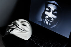 Vendetta mask on computeur Stock Photography