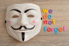 Vendetta mask displayed with we do not forget. This mask is a well-know symbol for the group Anonymous Royalty Free Stock Photography