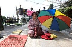 Vendeur de pièce de monnaie à Katmandou Photo stock