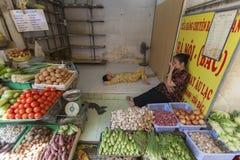 Vendeurs de légumes Images libres de droits