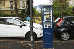 Vending Machine meter of car parking beside traffic road in Meran city Stock Photo
