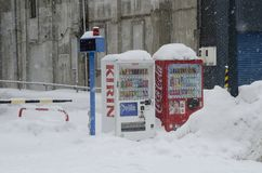 Vending machine on snow covered street. Kirin and Coca Cola vending machines on the street in Otaru Japan Royalty Free Stock Photos