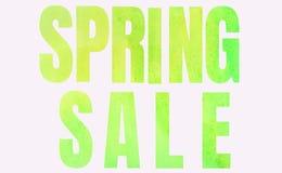 Vendita della primavera dell'iscrizione nel verde su un fondo bianco immagini stock libere da diritti